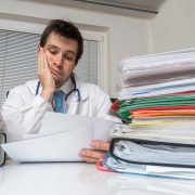Doctor frustrated with paperwork
